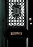 Klassiek voordeur in antiek groen met rooster