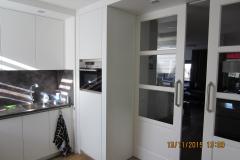 Schuifdeuren en-suite tussen keuken en WK